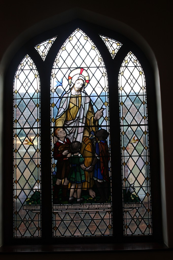 Stained glass window in Memorial Hospital Chapel: The Golden Window