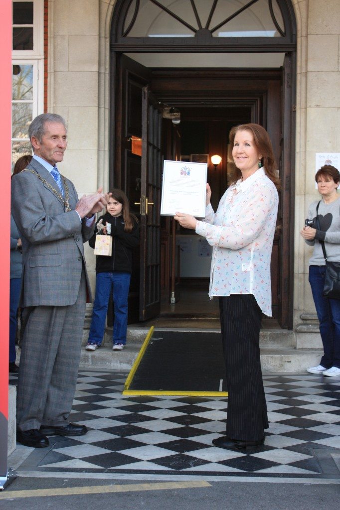 The Mayor  presents Shrewsbury House with a Commemorative Certificate representing the Royal Warrant recently issued to the Royal Borough