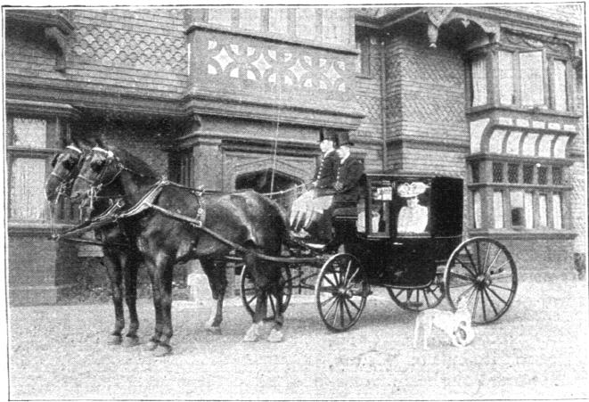 Maxine Elliot and her sister Gertrude in their carriage in front of Jackwood House