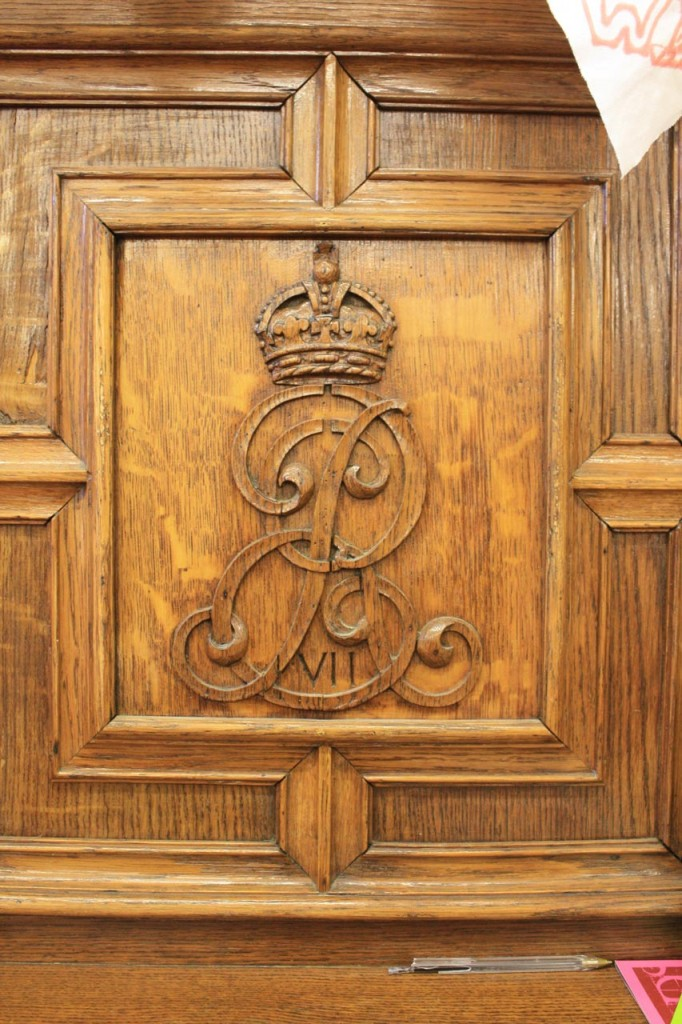 Carved crest in wooden mantelpiece in Victoria House