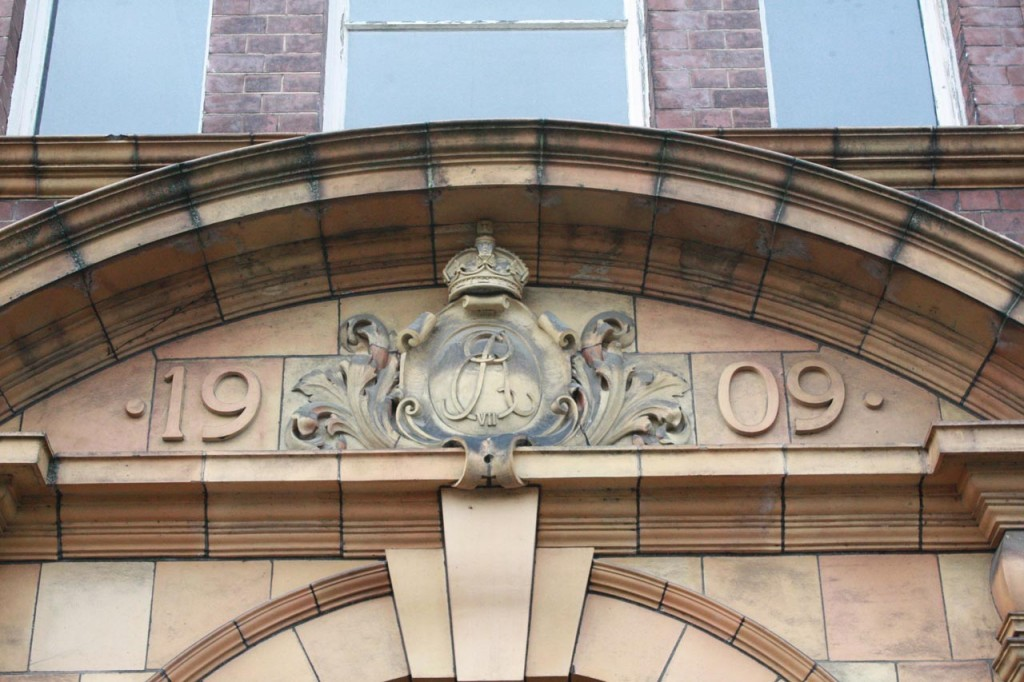 Edward VII initials and date over the entrance to Victoria House