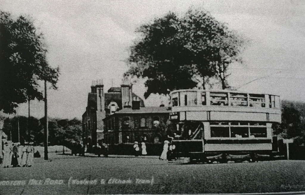 "A 4 wheeled tram passes Shooters Hill Police Station from David Lloyd Bathe's ""Steeped in History"""