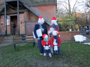 Father Christmas' scarecrow helpers